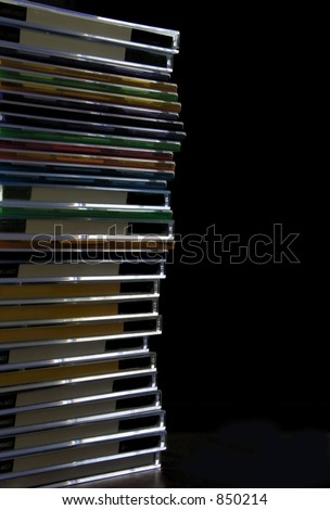 stack of cd's and dvd's isolated - stock photo