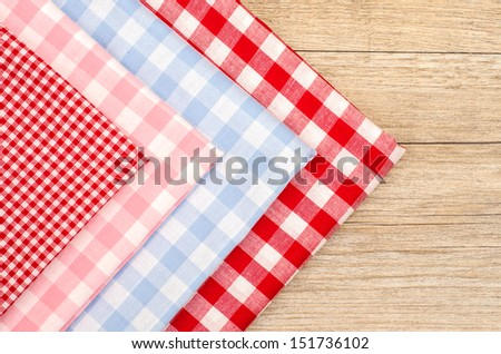 Stack of checkered cloths in red, blue and pink