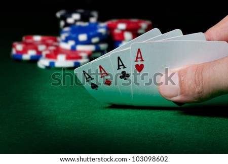 Stack of chips and four aces
