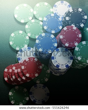 Stack of chips and four of kind poker combination on a green background. Poker game theme top view