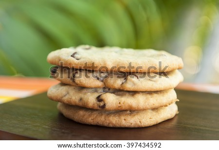 Stack of chocolate chip cookies outdoors in the summer