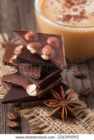 Stack of chocolate with nuts coffe and star anise - stock photo