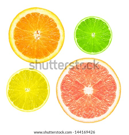 Stack of citrus fruit slices  isolated on white background. - stock photo