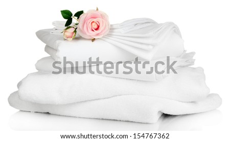 Stack of clean bedding sheets and towels isolated on white - stock photo