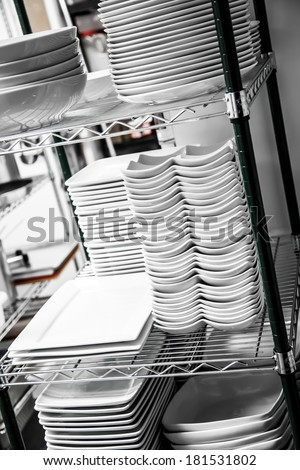 Stack of Cleaned Dishes in a Restaurant Room - stock photo