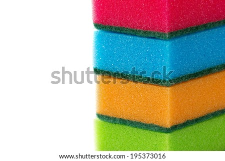 Stack of cleaning sponges isolated on a white background - stock photo