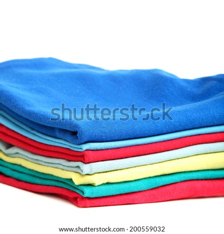 Stack of clothes isolated on white background. - stock photo