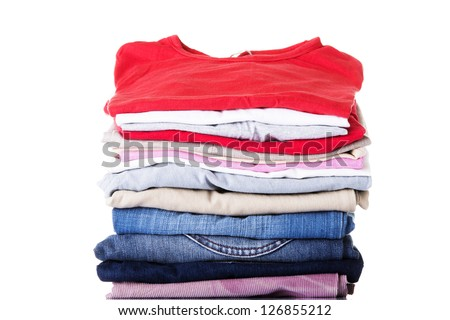 Stack of clothing isolated on white - stock photo