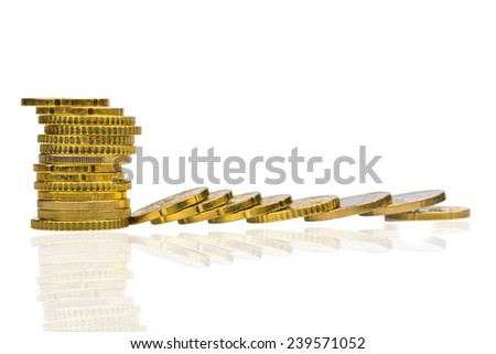 stack of coins and coins lying, symbolic photo for debt, profit slump and deductions - stock photo