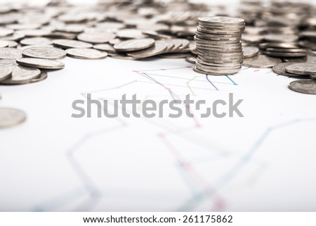 Stack of coins and graph background - stock photo