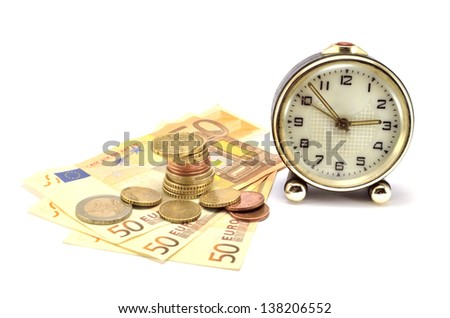 stack of coins, bank notes and clock on a white background