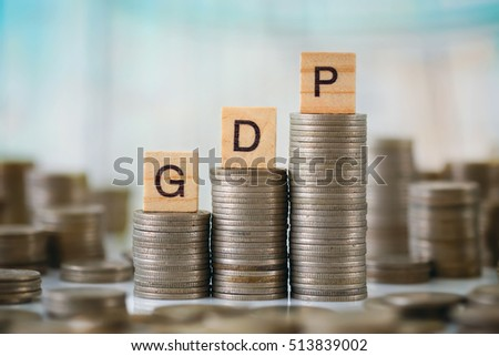 Stack of Coins with Wooden Plate Letters