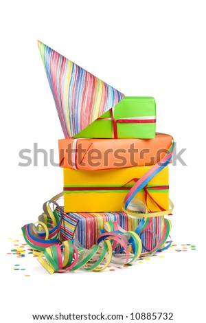 Stack of colored gift boxes with confetti and streamers