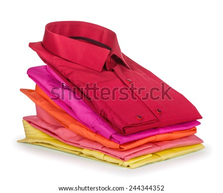 stack of colored shirt on a white background - stock photo