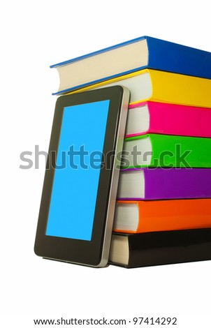 Stack of colorful books and tablet PC over white background - stock photo