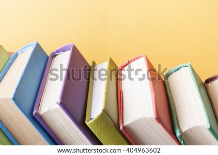 Stack of colorful books. Education background. Back to school. Copy space for text. - stock photo