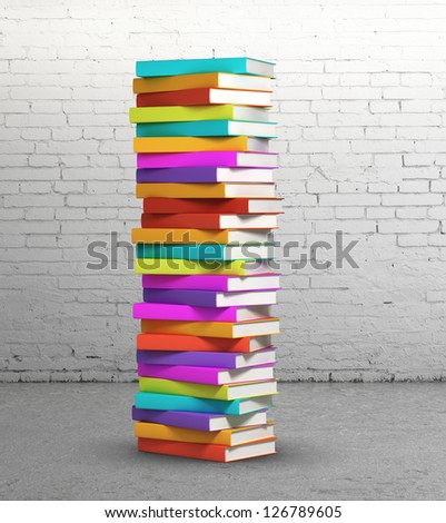 stack of colorful books on brick background