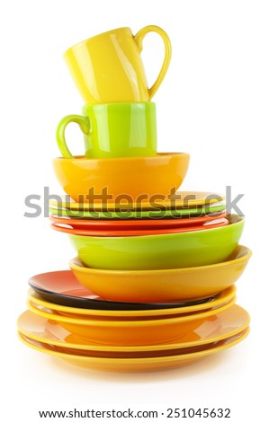 Stack of colorful ceramic dishware isolated on white background. - stock photo