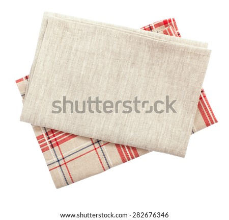 Stack of colorful dish towels isolated on white. Multi-colored linen napkins for restaurant. Flat mock up for design. Top view
