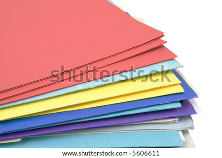 stack of colorful file folders isolated against white background