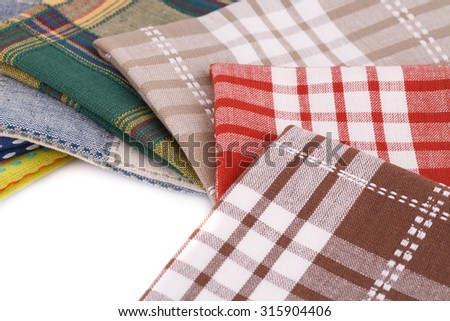 Stack of colorful kitchen towels closeup picture. - stock photo