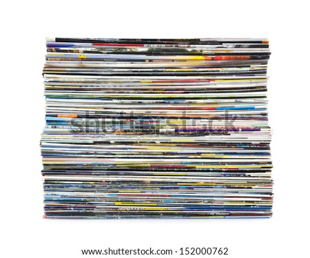 Stack of colorful magazines on white background - stock photo