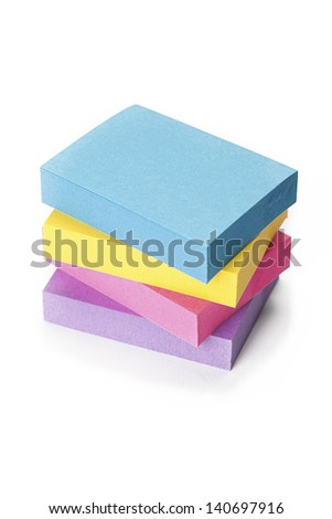 Stack of colorful office stationery. - stock photo