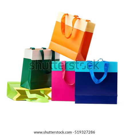 Stack of colorful shopping or gift bags isolated over the white background
