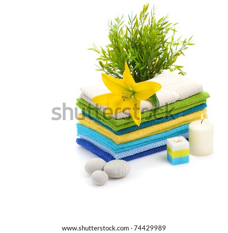 Spa candles isolated stock images royalty free images vectors stack of colorful towels with yellow lily and burn candles isolated on white background sciox Images