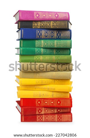 stack of colorful vintage books on white isolation - stock photo
