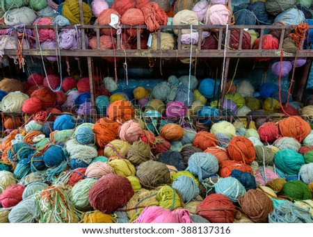 Stack of colorful yarns in a rug factory, Nepal - stock photo