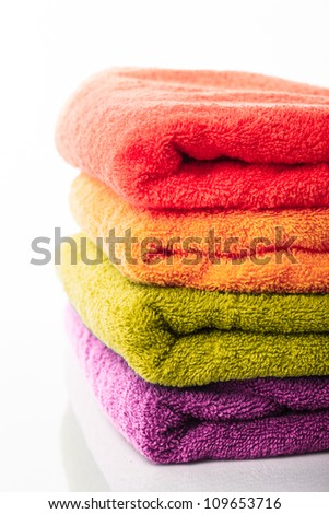 Stack of colorfull towels isolated on white - stock photo