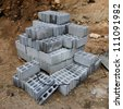 Stack of concrete blocks at the constructing site. - stock photo