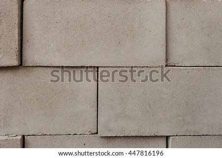 stack of concrete blocks, construction site. Grey bricks in a row for the production - stock photo