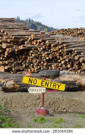 stack of conifer fir logs and no entry sign at a lumber mill in the Columbia River Gorge