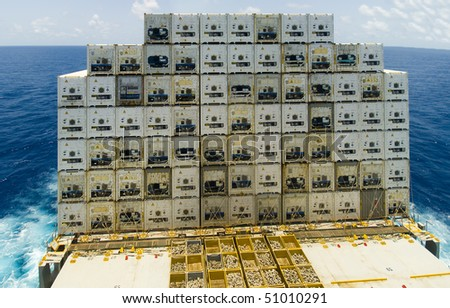 stack of containers on large container vessel ship - stock photo
