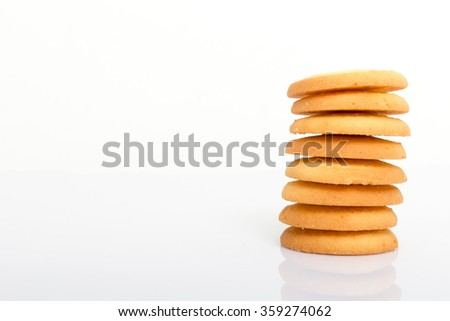 Stack of cookies isolated on white background with copy space. - stock photo