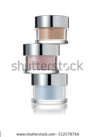 Stack of cosmetic jars - stock photo