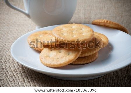 Stack of Crackers on plate - stock photo