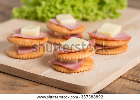 Stack of Crackers with Ham, Cheese. - stock photo