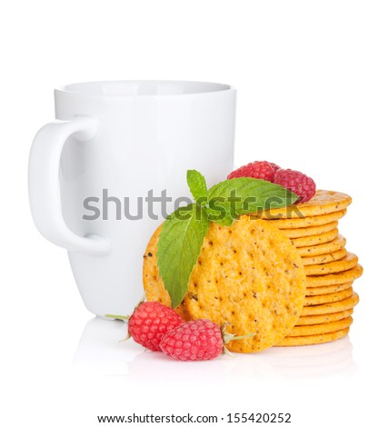 Stack of crackers with mint, berries and cup of drink. Isolated on white background - stock photo