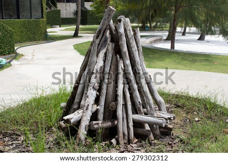 stack of cut logs fire wood in front of resort - stock photo