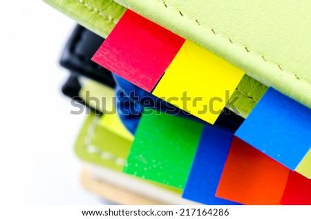 Stack of dairy with sticky notes - stock photo