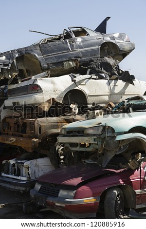 Stack of damaged cars in junkyard
