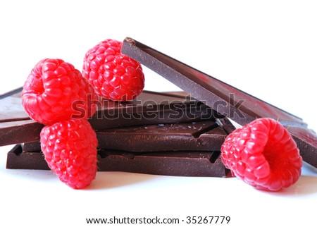 Stack of dark chocolate with raspberries - stock photo