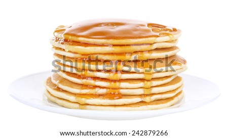 Stack of delicious pancakes with honey on plate isolated on white - stock photo