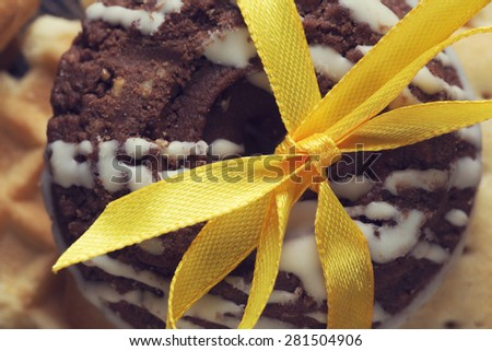 Stack of delisious cookies and biscuits folded with ribbon - stock photo