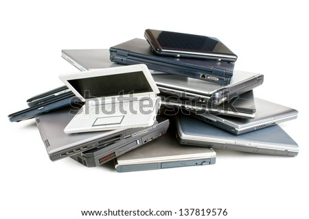 Stack of different sized and aged laptops, isolated on white background with shadow - stock photo