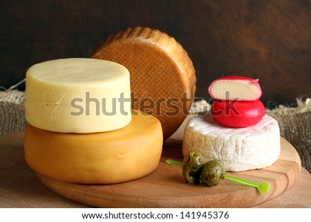 stack  of different types of cheese - stock photo
