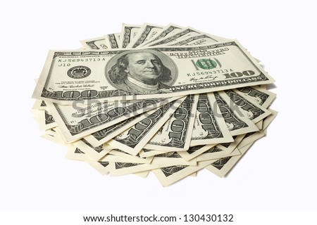 stack of dollar bills lying on a white background